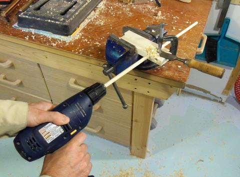 homemade dowel maker. making the dowels is as simple putting dowel blank in drill chuck and pushing it through jig while spinning it. homemade maker