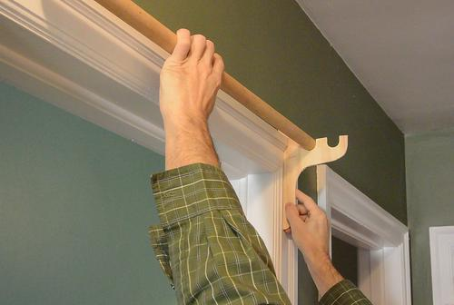I wanted to make some hooks to screw onto the door frame to hold a dowel as high as it could go while still allowing the coat hangers to hang off of ... & Door coat hanger bar