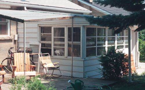 The Old Sunroom Had Vertical Sliding Windows All Around And Aluminium Siding Against Walls Were Just Single Pane But With Storm On
