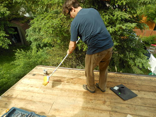 Marleneu0027s Husband Olivier Sweeping Off The Roof Before Starting To Put On Tar  Paper. The Old Roof Didnu0027t Have Any Tar Paper On It.