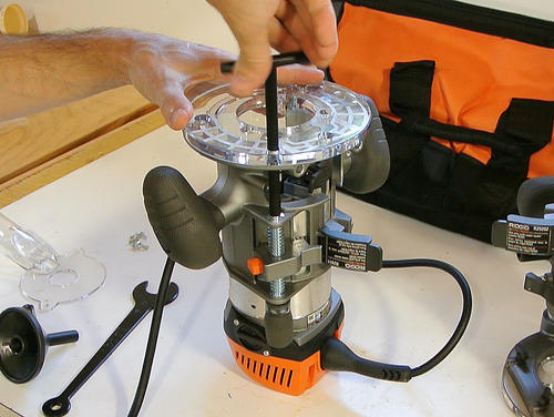 Ridgid fixed base router with plunge base review this fits through the base of the router so that the depth can be adjusted from above the table greentooth Choice Image