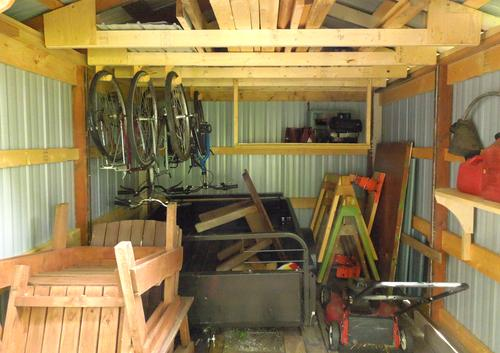 So I added some hooksfor hanging bicycles, and a deep shelf in the ...
