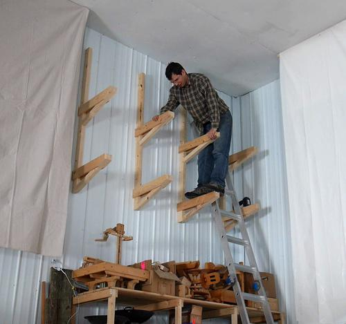 Checking The Strength By Standing On One Of Shelf Brackets