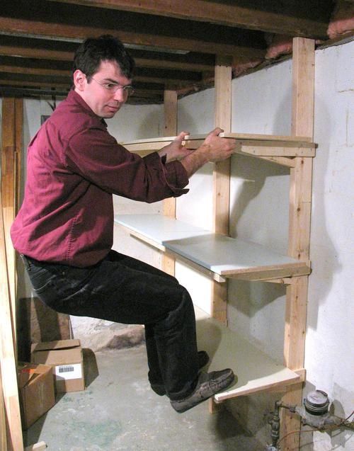 Here's testing the strength of the shelf. The verticals are screwed ...