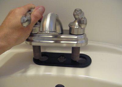 Installing a new bathroom faucet - Installing a new bathroom sink faucet ...