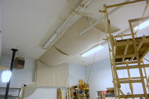 i hung two 26x35 meters drop cloths on the ceiling and one drop cloth on each of the opposite walls just the four drop cloths made